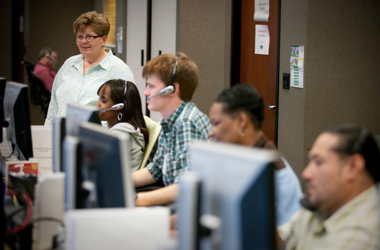 Operators speak with customers at BP America's Houston call center in July 2010. (BP America/Flickr)