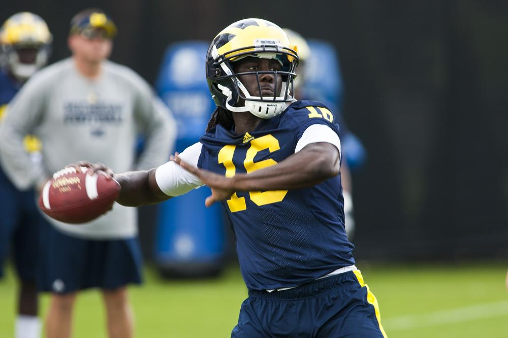 Michigan quarterback Denard Robinson throws a pass during practice, Tuesday in Ann Arbor, Mich. (AP)