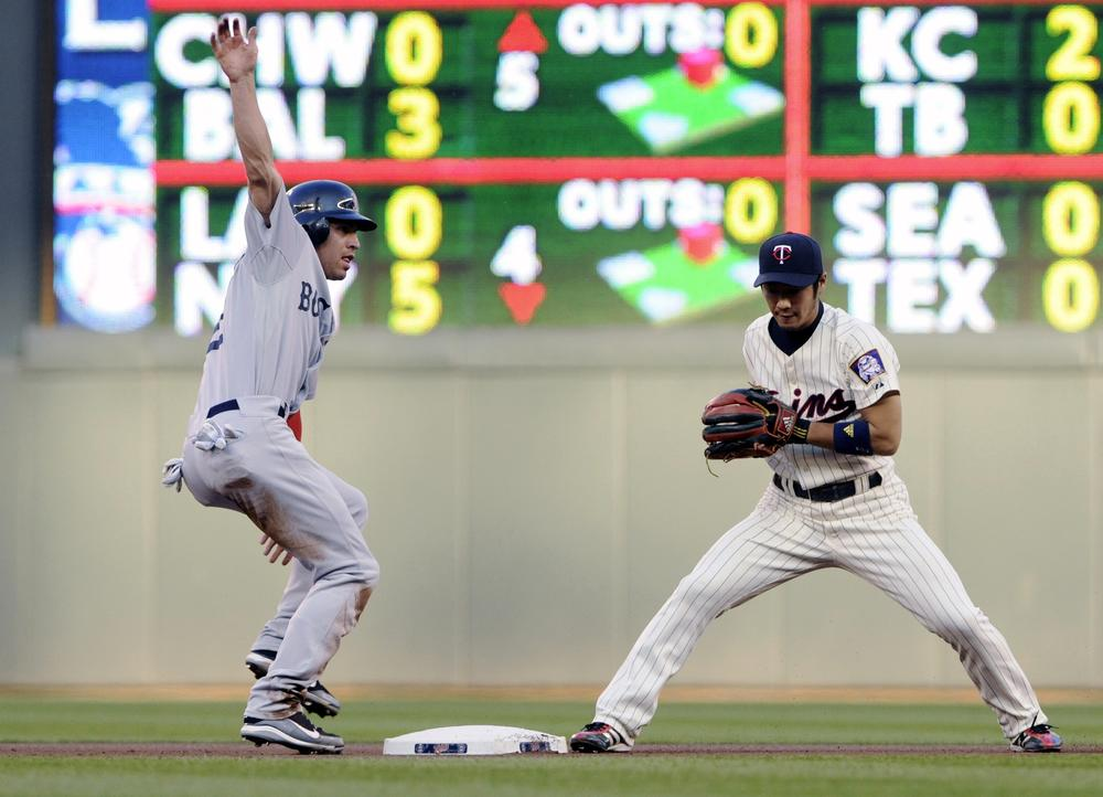 Boston's Jacob Ellsbury, left, is forced out at second by Minnesota Twins shortstop Tsuyoshi Nishioka on a fielder's choice hit into by Adrian Gonzalez. (AP)