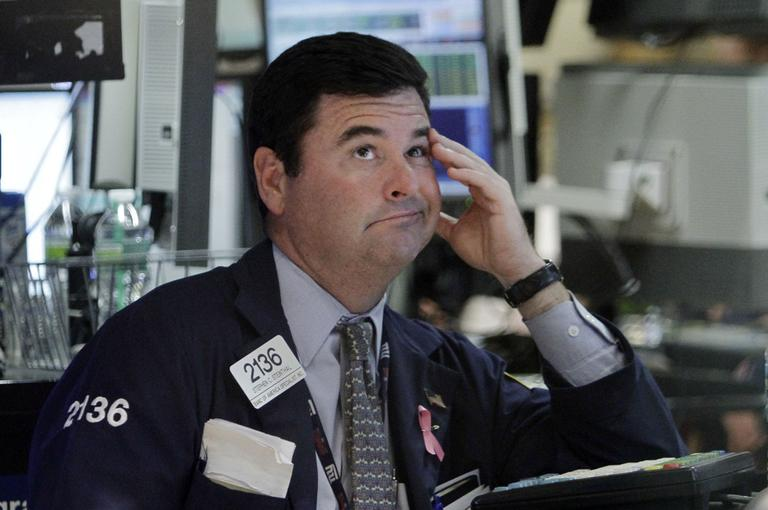 Specialist Stephen Steinthal works at his post on the floor of the New York Stock Exchange Wednesday, Aug. 10, 2011. (AP)