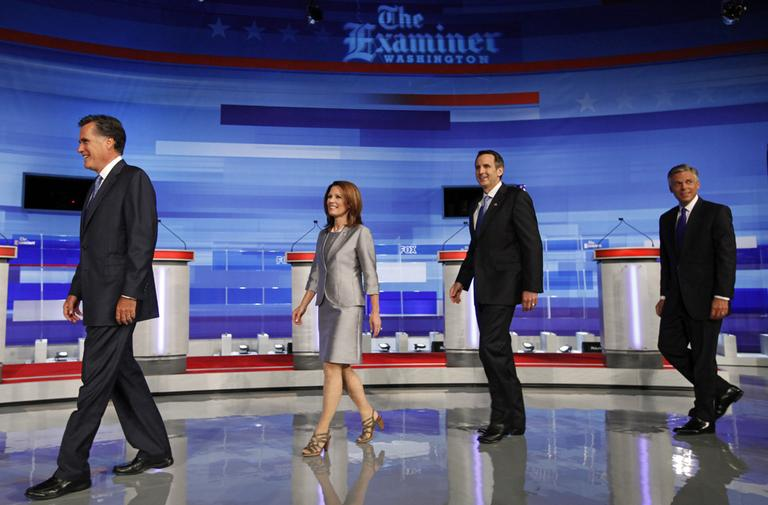 Republican presidential candidates including Mitt Romney, Michele Bachmann, Tim Pawlenty, and Jon Huntsman walk on stage for a photo before the start of the Iowa GOP/Fox News Debate in Ames, Iowa. (AP)