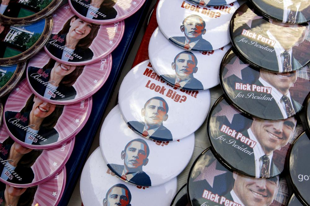 Campaign buttons for Republican presidential candidates Rep. Michele Bachmann, R-Minn. and Texas Gov. Rick Perry are seen along with ones that are anti-President Barack Obama buttons at yesterday's Black Hawk County Republican Party Lincoln Day Dinner in Waterloo, Iowa. (AP)