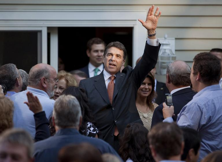 Republican presidential candidate Texas Gov. Rick Perry arrives for a house party in Greenland, N.H., Saturday. (AP)