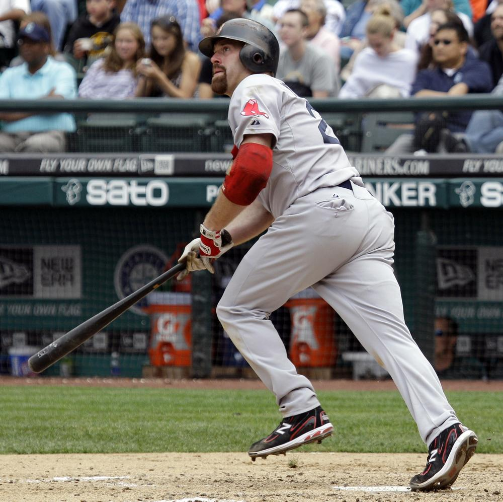 Boston's Kevin Youkilis watches his two-run home run in the eighth inning against Seattle on Sunday. (AP)