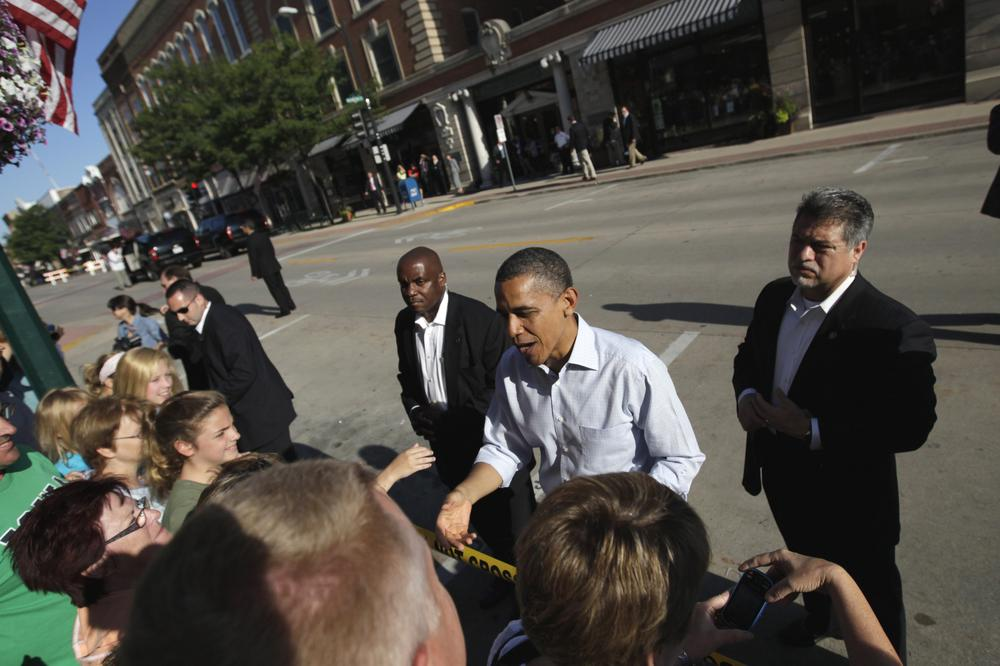 President Obama greets people in downtown Decorah, Iowa, on Tuesday during his three-day economic bus tour. (AP)