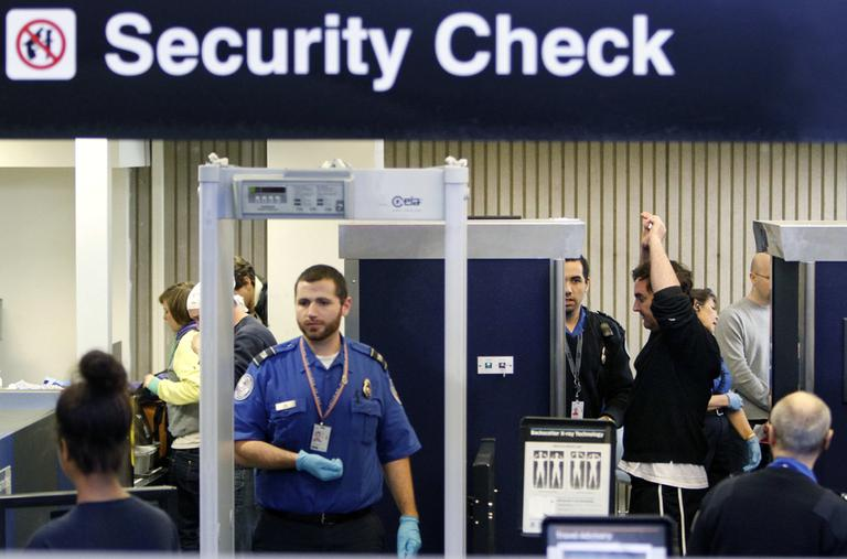 Passengers pass through a security checkpoint at Logan Airport in October 2010. (AP)