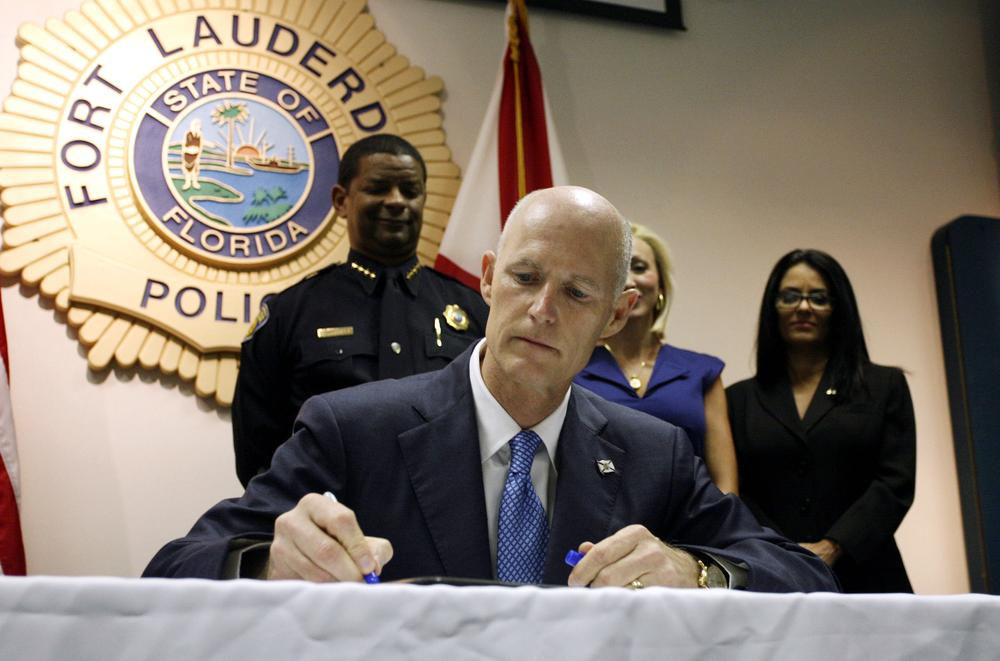 "Florida Gov. Rick Scott signs a law aimed at controlling the state's ""pill mills"" in June, 2011. (AP)"