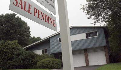 Fixed mortgage rates fell to at or near record lows Thursday, Aug. 11, 2011. That's good news for the few who can afford to buy a home or are able to refinance. But the rates have done little to lift the ailing housing market. (AP)