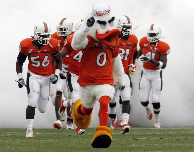 The Miami Hurricanes mascot leads the team onto the field for Miami's 2011 spring football game. (AP)