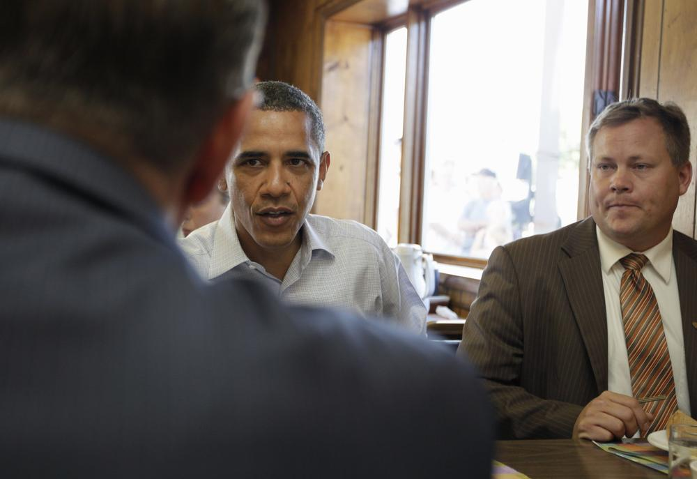 President Barack Obama stops for breakfast with small business owners on Tuesday at Rausch's Cafe in Guttenberg, Iowa, during his Midwest bus tour. (AP)