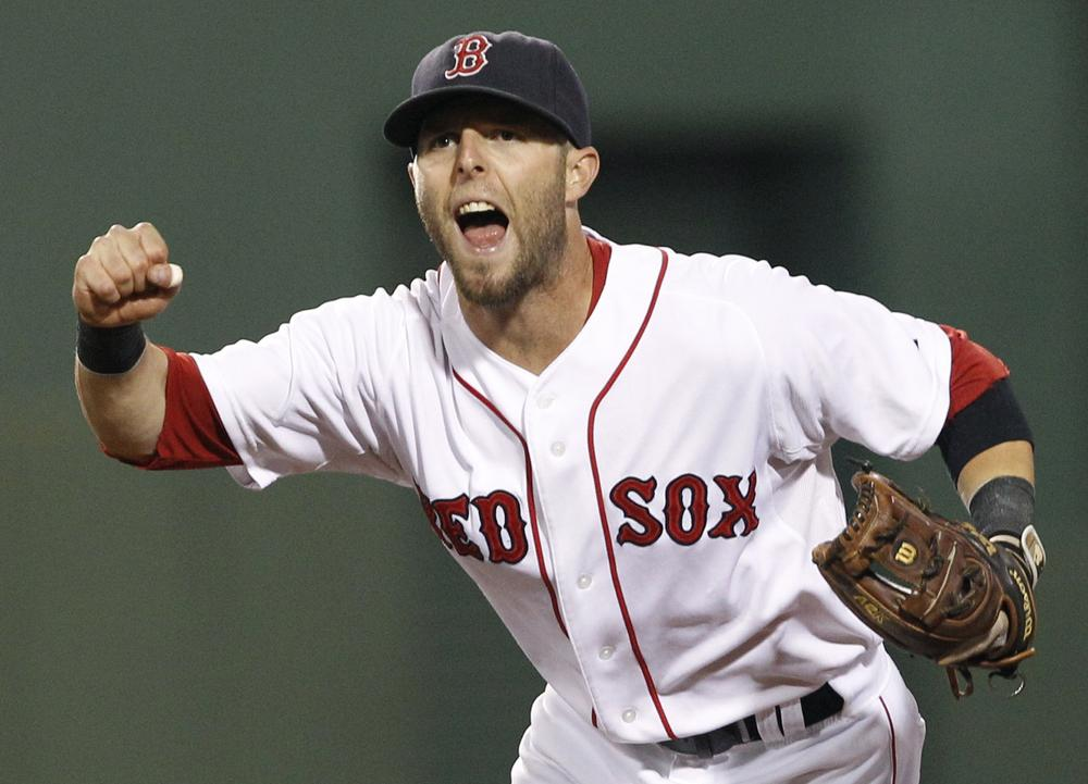 Boston Red Sox second baseman Dustin Pedroia celebrates the completion of a triple play against the Tampa Bay Rays during the fourth inning of the game of a doubleheader in Boston on Tuesday. Pedroia threw out Rays' Sean Rodriguez at first to get the final out. (AP)