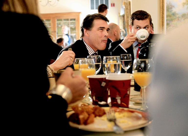 Republican presidential candidate Texas Gov. Rick Perry, with son Griffin, right, attend the Politics and Eggs Breakfast Wednesday in Bedford, N.H. (AP)