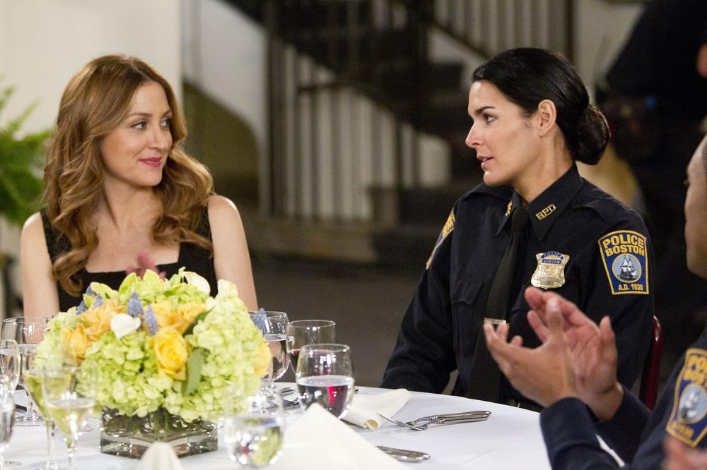 "In this publicity image released by TNT, Sasha Alexander, left, and Angie Harmon are shown in a scene from the series ""Rizzoli & Isles."" (AP)"