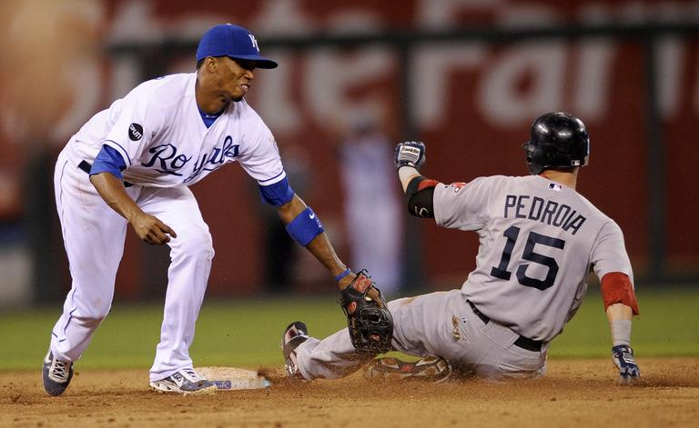 Royals shortstop Alcides Escobar tags out the Sox's Dustin Pedroia at second base in the fifth inning Thursday in Kansas City. (AP)