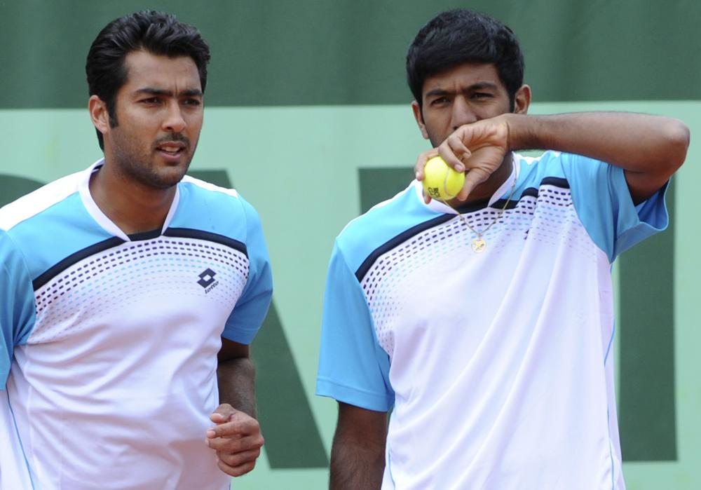 Pakistan's Aisam-ul-haq Qureshi, left, and India's Rohan Bopanna play at the French Open in May. (AP)