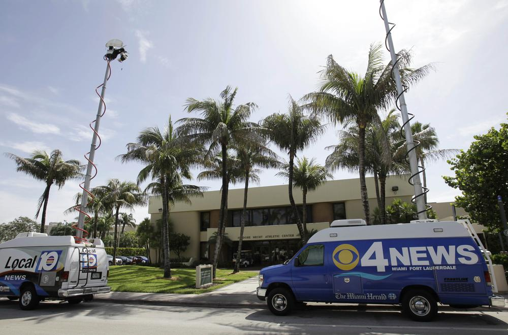 NCAA investigators and television news trucks were on the University of Miami campus this week to investigate allegations by former booster Nevin Shapiro. (AP)