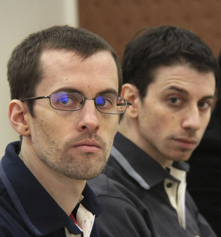 US hikers Shane Bauer, left, and Josh Fattal, attend their trail at the Tehran Revolutionary Court, Iran on Feb. 6, 2011. (AP/File)