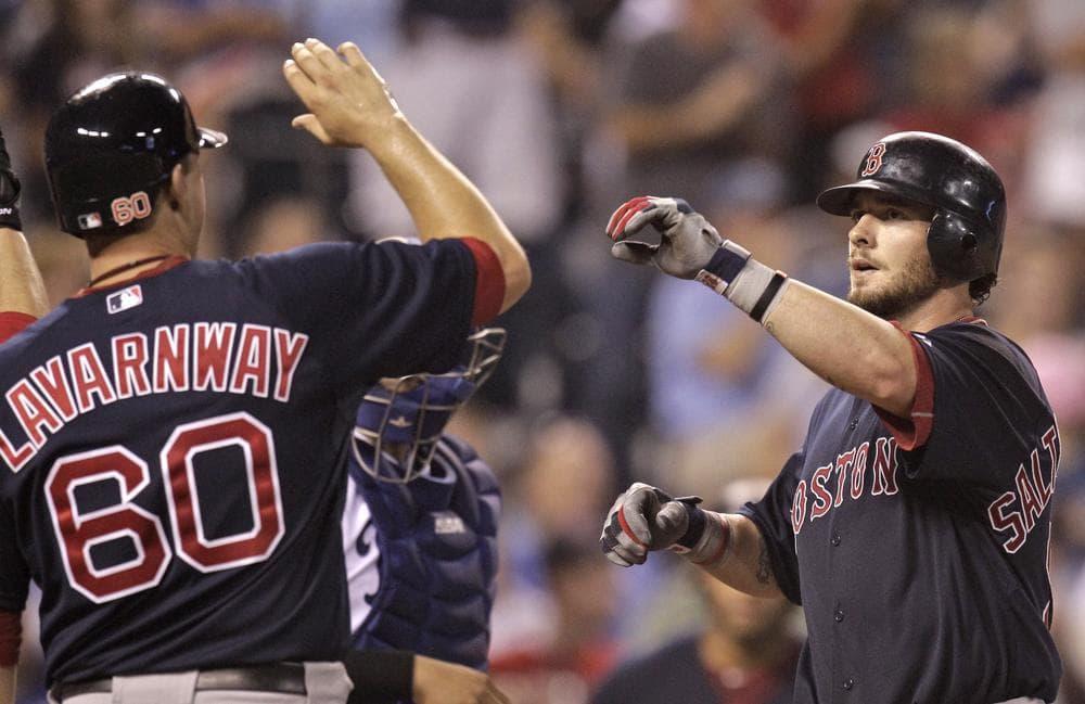 Red Sox's Jarrod Saltalamacchia, right, celebrates with Ryan Lavarnway after hitting a three-run home run. (AP)