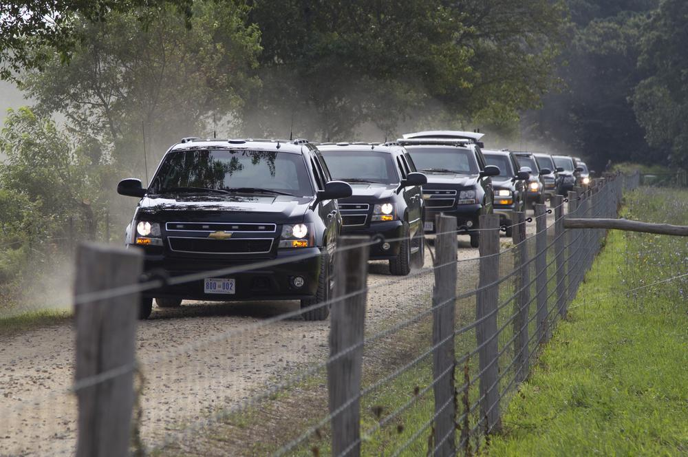 A motorcade with President Obama and his family moves from Blue Heron Farm in Chilmark to a beach in Edgartown, Sunday.  (AP)