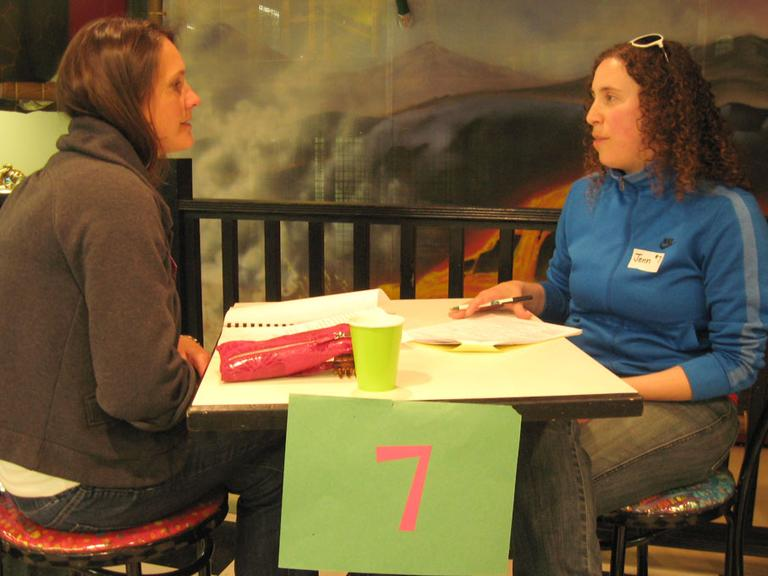 """Andover mother Theresa Dowling, left, interviews prospective babysitter Jenn Phaneuf of Lawrence at a """"Sitter Mixer"""" event. (Sacha Pfeiffer/WBUR)"""