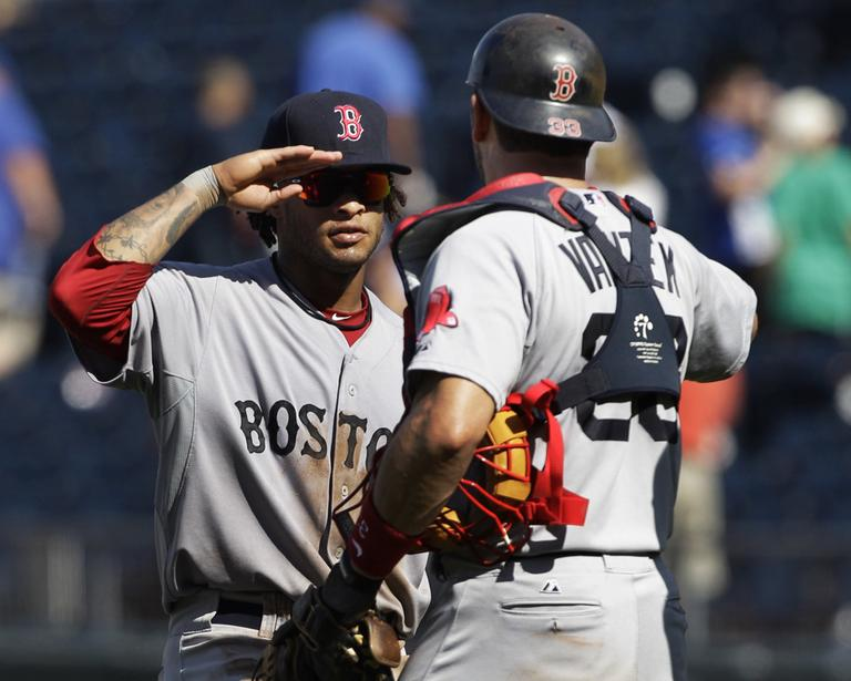 Sox left fielder Darnell McDonald, left, salutes catcher Jason Varitek after beating the Royals on Sunday. (AP)