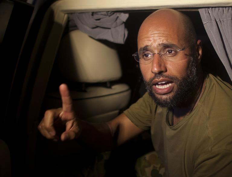 Moammar Gadhafi's son, Seif al-Islam, speaks outside of the Rixos hotel in Tripoli, Libya, Tuesday. (AP)