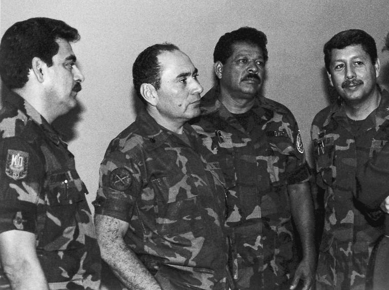 This July 1989 photo shows Col. Inocente Orlando Montano (second from right), then public safety vice minister, and El Salvadorian army colleagues in an undisclosed location in El Salvador. (AP)