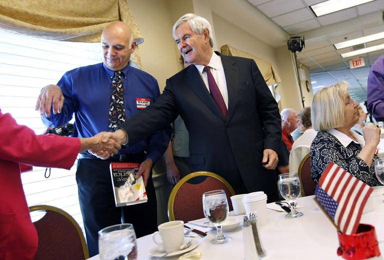 Republican presidential hopeful Newt Gingrich greets voters at the Portsmouth Country Club in Portsmouth, N.H., in May. (AP)