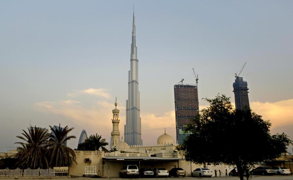 With World's tallest tower, Burj Khalifa in background, children play next to a mosque in Dubai, United Arab Emirates. (AP)