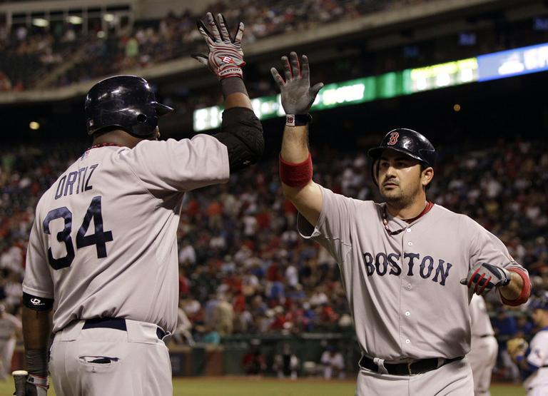 Boston Red Sox's David Ortiz congratulates Adrian Gonzalez, right, on his two run home run in the eighth inning against the Texas Rangers on Wednesday. (AP)