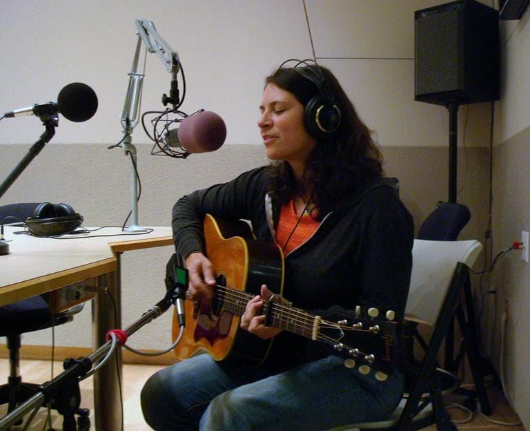 Kris Delmhorst gets ready to perform in Radio Boston's Studio 3. (Adam Ragusea/WBUR)
