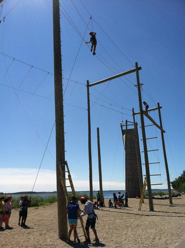 Children from the camp on a tightrope course (Delores Handy/WBUR)