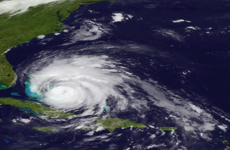 In an image provided by the National Oceanic and Atmospheric Administration, Hurricane Irene moves over the Bahamas, Thursday. (AP)