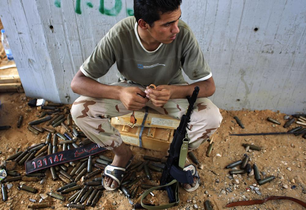 A rebel fighter seen at the checkpoint near the Tripoli International Airport outside Tripoli, LIbya, Friday.  (AP)