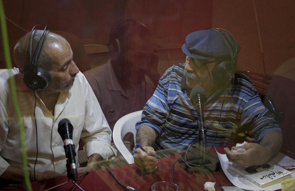 Journalists seen inside the Voice of Free Libya radio station studio in the rebel-held town of Benghazi, Libya. (AP)