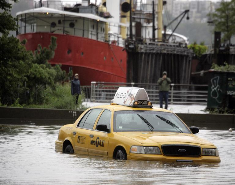A New York City taxi is stranded in deep water on Manhattan