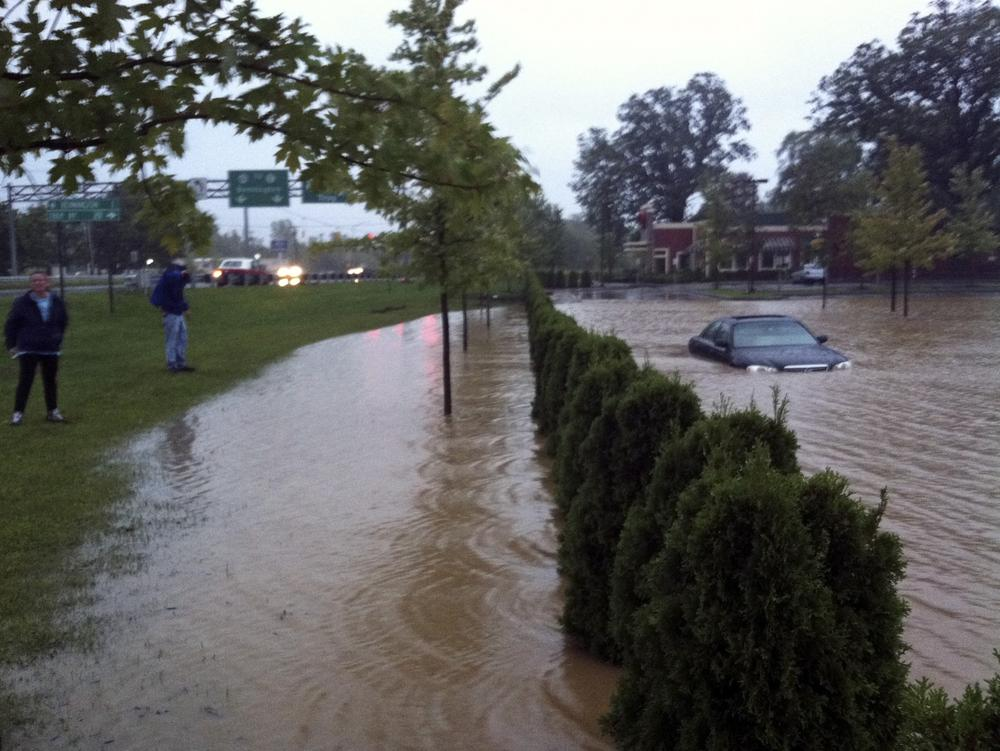 In this photo provided by Sarah Jones, a supermarket parking lot is flooded with rain water from Tropical Storm Irene in Bennington, Vt. (AP)