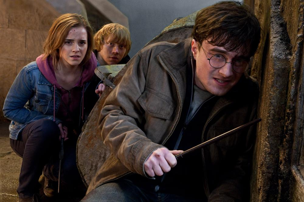 "Emma Watson, Rupert Grint and Daniel Radcliffe are shown in a scene from ""Harry Potter and the Deathly Hallows: Part 2."" (AP/Warner Bros. Pictures)"