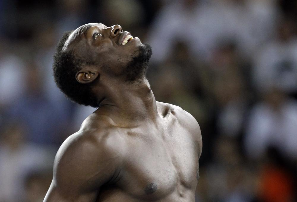 Jamaica's Usain Bolt reacts after being disqualified after a false start in the Men's 100m final at the World Athletics Championships in Daegu, South Korea, Sunday. (AP)