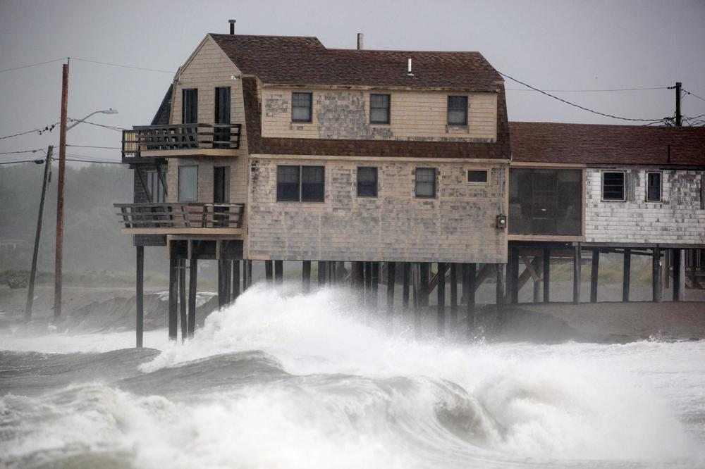 Waves roll ashore in Scituate, Mass., as Tropical Storm Irene moved through the area, Sunday. (AP)