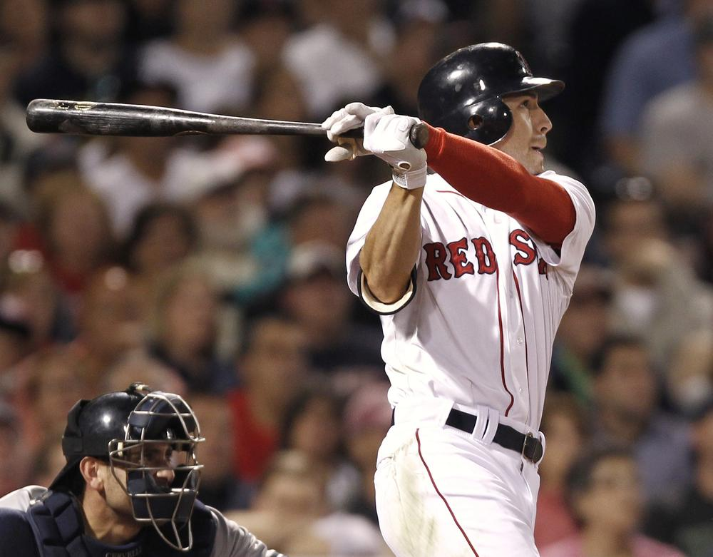Boston's Jacoby Ellsbury follows through on his two-run home run against New York during the sixth inning of the game in Boston on Wednesday. (AP)