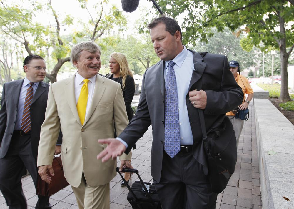 Roger Clemens and his attorney Rusty Hardin arrived yesterday at federal court in Washington. Clemens was granted a new trial to begin in April. (AP)