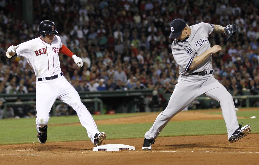 New York Yankees starting pitcher A.J. Burnett misses the bag as the Sox's Jacoby Ellsbury is safe at first. (AP)