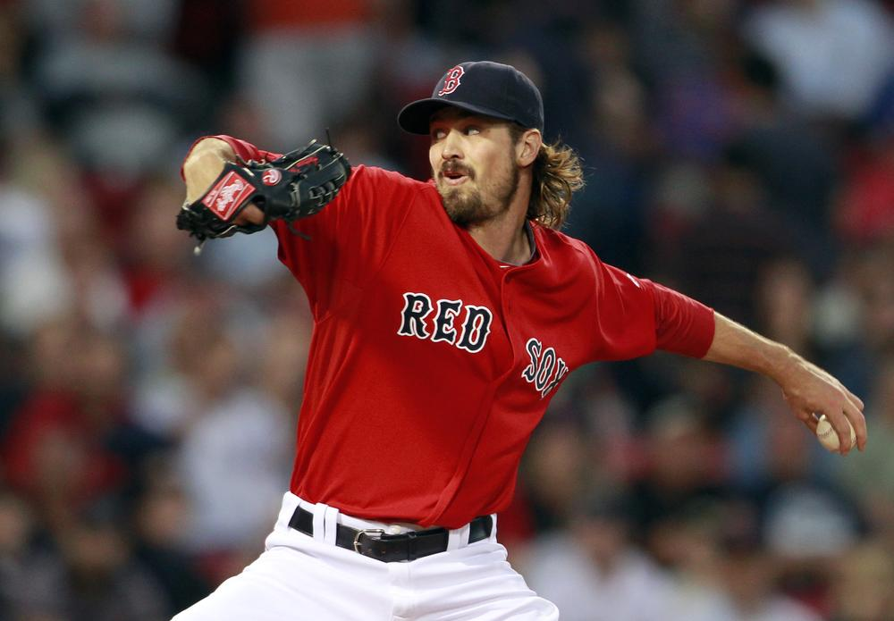 Red Sox's Andrew Miller pitches in the first inning Friday night. (AP)