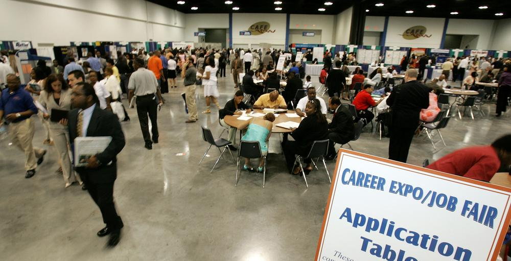Attendees walk to company booths at a Georgia Department of Labor job fair. (AP)