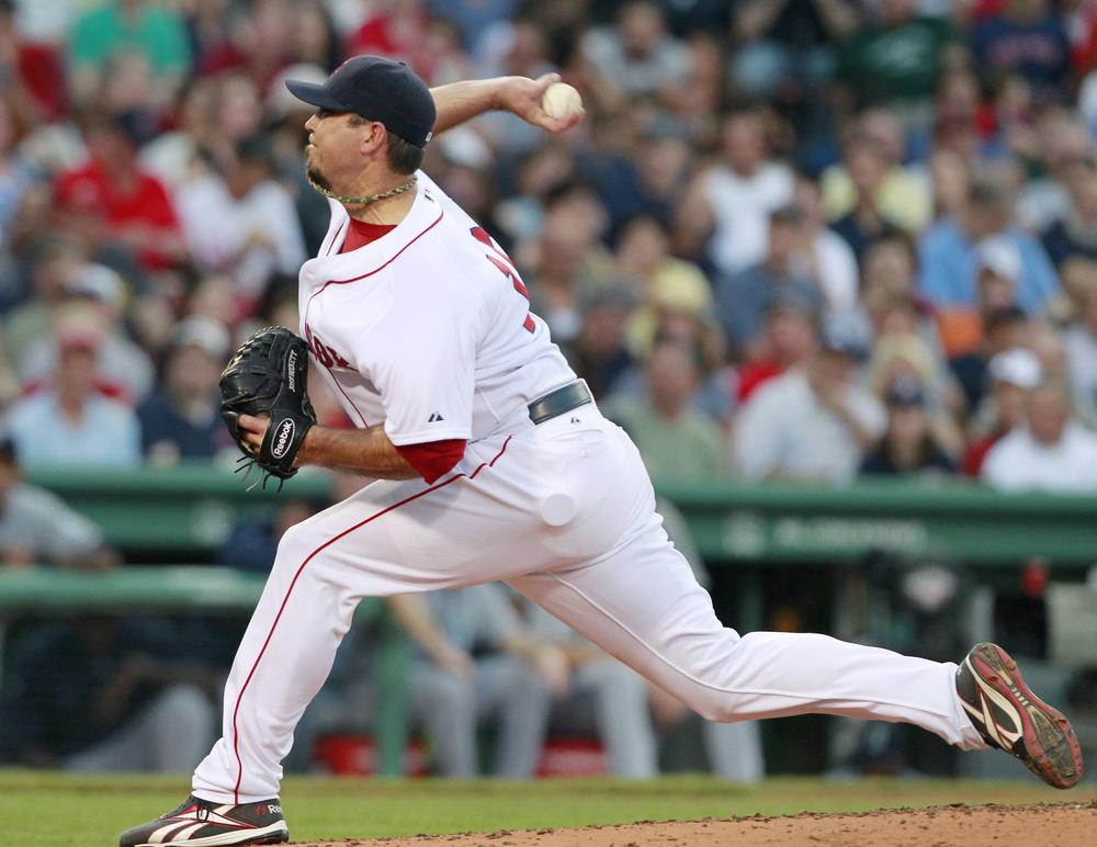 Boston Red Sox's Josh Beckett pitches in the second inning of a baseball game against the Seattle Mariners in Boston on July 23, 2011. (AP)