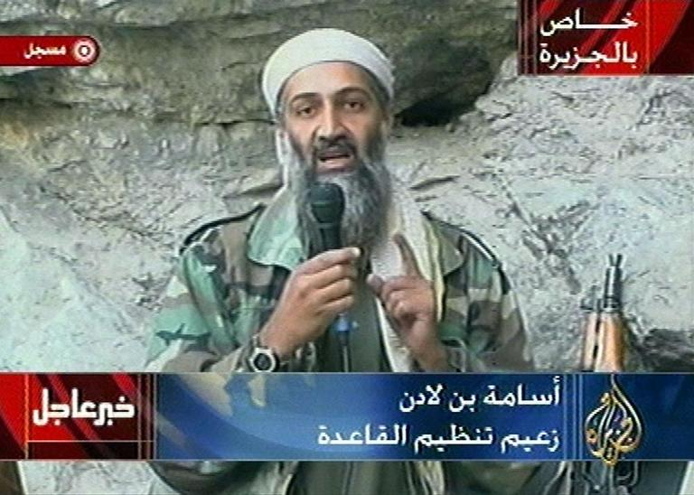 Osama bin Laden is seen at an undisclosed location in this television image broadcast Sunday Oct. 7, 2001.