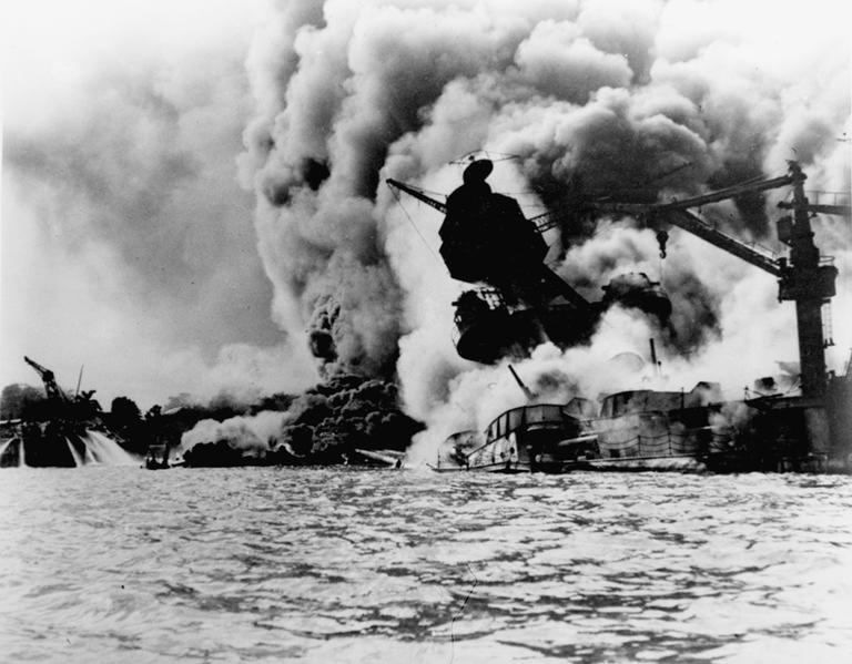 The USS Arizona burns after the attacks on Pearl Harbor, December 7, 1941. (AP)