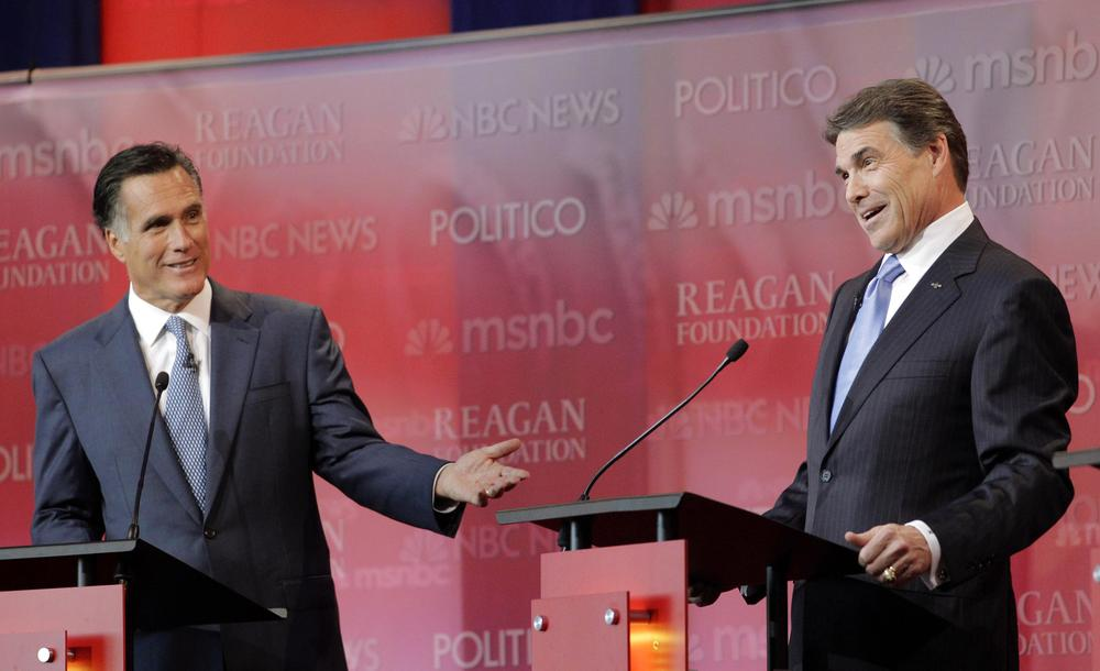 Republican presidential candidates former Massachusetts Gov. Mitt Romney, left, and Texas Gov. Rick Perry answer a question during a Republican presidential candidate debate in Simi Valley, Calif. (AP)