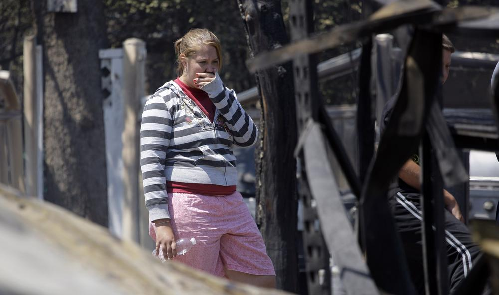 Laura Clements surveys her fire-destroyed home in Bastrop, Texas. The Clements lost their home to fires Monday. (AP)